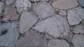 Stone floor with some dust and tiny stones. On the floor Stock Images