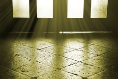 Stone floor and wooden door with some light rays. Mystery background Stock Photo