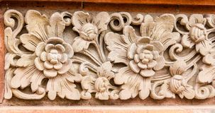 Stone flower pattern in temple of Ubud. Stock Photo