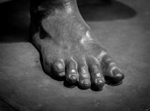 Stone foot of ancient Roman statue Royalty Free Stock Photos