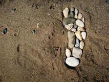 Foot  in the sand Royalty Free Stock Photo