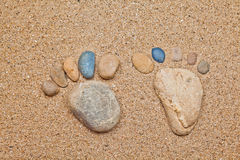 Stone foot in the sand Royalty Free Stock Image