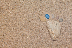 Stone foot in the sand Stock Photos