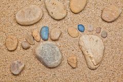 Stone foot in the sand Stock Images