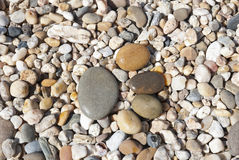 Stone foot on the stony beach Royalty Free Stock Images