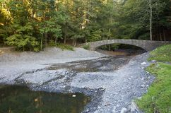 Stone footbridge at Fillmore Glen State Park in Moravia, NY Royalty Free Stock Photography