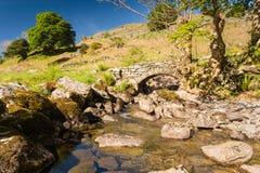 Stone footbridge over Rowentreethwaite Beck Royalty Free Stock Image