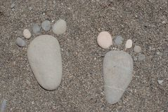 Stone foots on the beach Stock Image