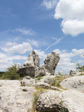 Stone forest (Pobiti Kamani) under the sky , near Varna, the sto. The stone in the shape of the mouth of the dragon, on the background of clouds Royalty Free Stock Photo
