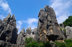 Stone forest and sky. Stone forest in Yunnan Province, China。This is a rare type of karst topography。China's largest stone forest karst landforms stock photos