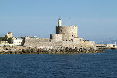 Stone Fort of St. Nicholas with the lighthouse in the harbor of royalty free stock photos