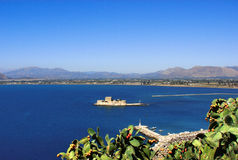 Stone Fortress on an Isle. Old fortress on a little islet in the middle of a Mediterranean blue gulf Stock Photography