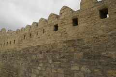 Stone fortress wall with grey sky Stock Image