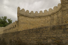 Stone fortress wall with grey sky Stock Images