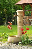 Stone fountain in the backyard Royalty Free Stock Images