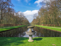 Stone fountain. By the beautiful pond in the park of Kasteel De Haar Royalty Free Stock Images