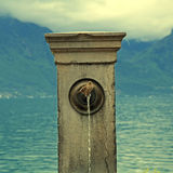 Stone fountain with bird, Lake Geneva Stock Image
