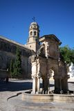 Stone fountain and Cathedral, Baeza, Spain. Royalty Free Stock Photo