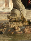 Stone fountain in the dragon shape. Stone fountain in the shape of a dragon spurts water royalty free stock photo