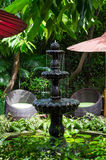 Stone fountain in the garden. Classic style stone fountain in the garden stock image