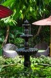 Stone fountain in the garden Stock Image