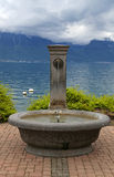 stone fountain, Lake Geneva, Switzerland. Royalty Free Stock Photos