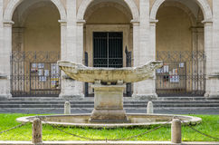 Stone fountain marble monument in the form of the ancient ship at the entrance to the park in the capital of Italy, Rome Royalty Free Stock Photo