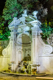 Stone fountain Prigione autumn night in Rome, Italy Royalty Free Stock Photo