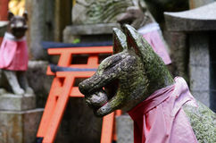 Stone fox at Fushimi Inari shrine,Kyoto Japan. Stone image of guardian foxes of Fushimi Inari Taisha Shine in Kyoto Japan Stock Photography