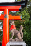 Stone fox on guard at Fushimi Inari Shrine Stock Photography