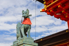 Stone fox on guard at Fushimi Inari Shrine Stock Image