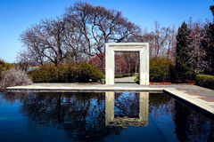 Stone Frame and Reflection. Stone frame and trees reflected on the water Stock Image