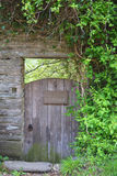 Stone Framed Old Cottage Gate. This is an old gate that leads to a cottage in the UK.  It is framed by stone and greenery Stock Photos
