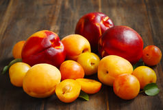 Stone Fruits On Wooden Background. Yellow Plums, Apricots And Nectarines