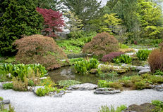Stone Garden. English stone garden with pond in the middle Stock Photos
