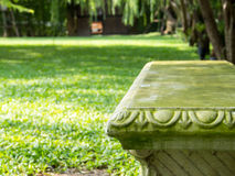 Stone Garden Bench on Park Background Royalty Free Stock Photo