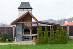 Stone garden oven for grill or barbeque is in a backyard. Backyard patio area with fireplace. BBQ area stock photos