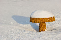Stone garden table in snow Royalty Free Stock Image