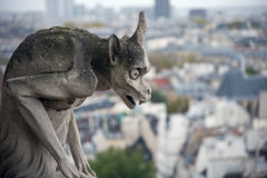 Stone gargoyle overlooking Paris from the Notre Dame Stock Image