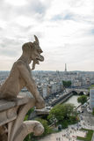 Stone Gargoyle on Notre Dame Cathedral Stock Photography