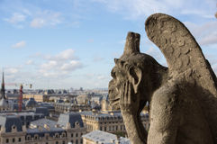 Stone gargoyle overlooking Paris Royalty Free Stock Photos