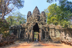Stone Gate of Angkor Thom in Cambodia. Angkor Wat is the largest religious monument in the world. Royalty Free Stock Image