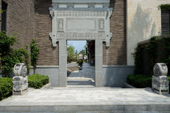 Stone gate with bass-releif of archaised Chinese building Stock Photos