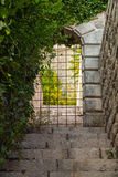 Stone gate locked with steel grating Royalty Free Stock Photo