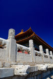Stone gate and roof tops in forbidden city in Beijing Royalty Free Stock Images