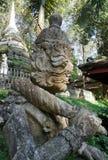 Stone Giant sculpture guarding the temple. Giant carry a club on shoulder guarding the temple in the garden Stock Photos