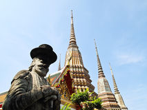 Stone Giant statue at Wat Pho Bangkok, Thailand Stock Photos