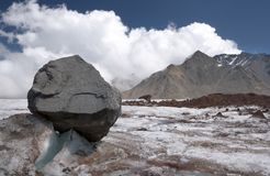 Stone on the glacier moraine in Caucasus mountains Stock Photography