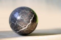 Stone globe. A stone globe on a horizontal surface Royalty Free Stock Photos