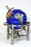 Stone globe on chrome stand Royalty Free Stock Photos